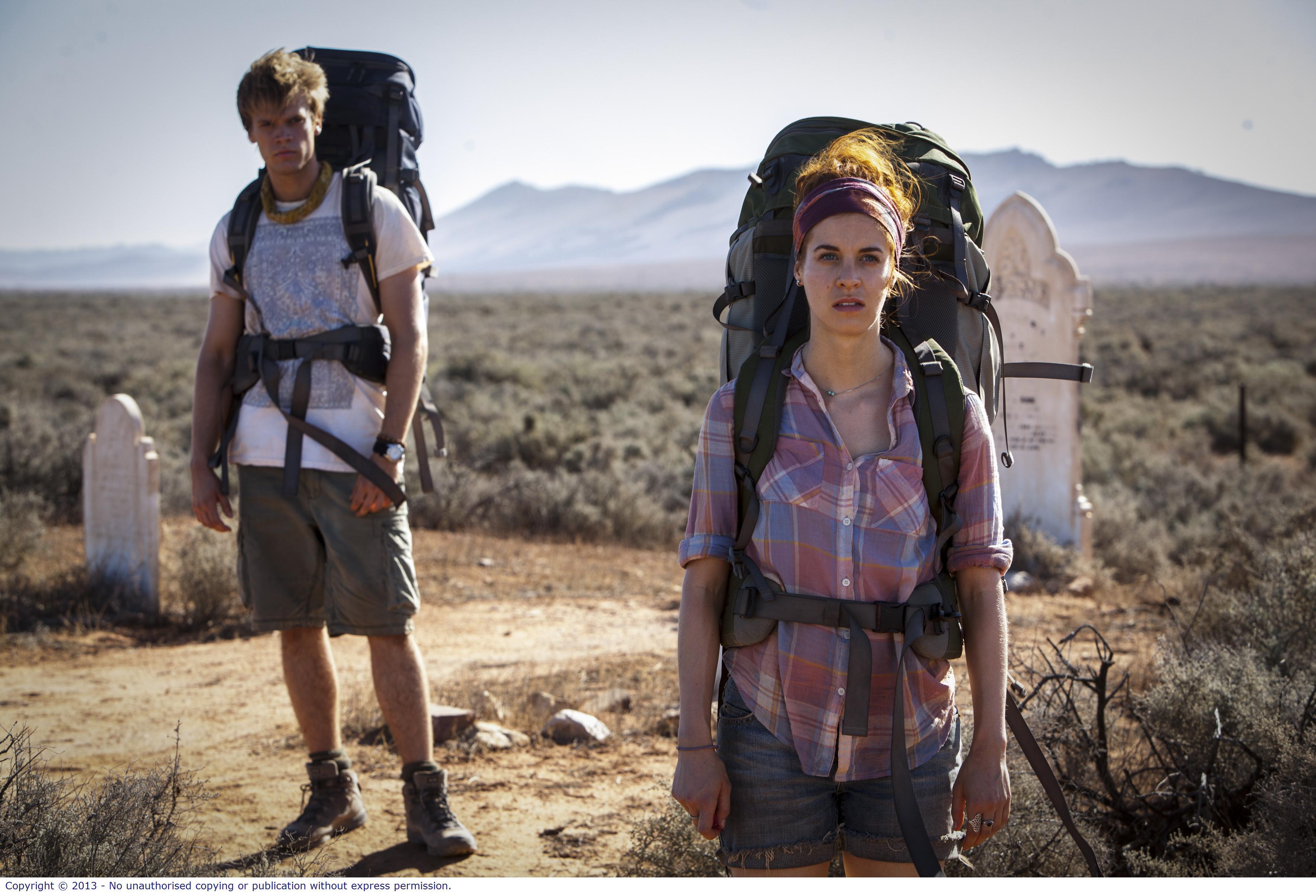 WolfCreek2_L-R Phillipe Klaus as Rutger and Shannon Ashlyn as Katarina_bush grave