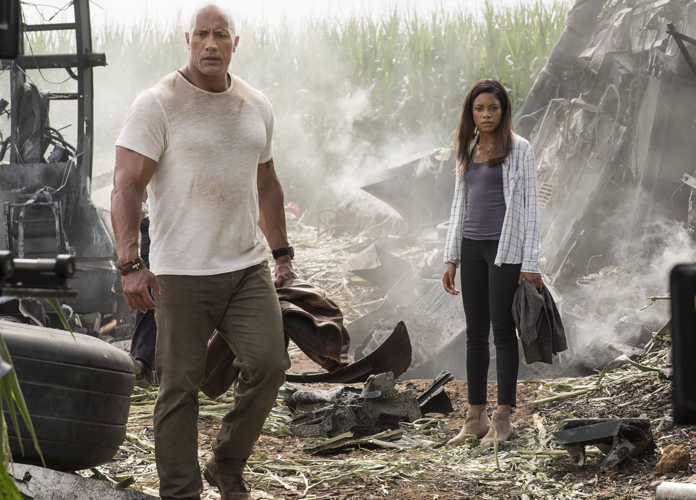 """(L-R) DWAYNE JOHNSON as Davis Okoye and NAOMIE HARRIS in New Line Cinema's action adventure """"RAMPAGE,"""" a Warner Bros. Pictures' release. Photo by Frank Masi"""