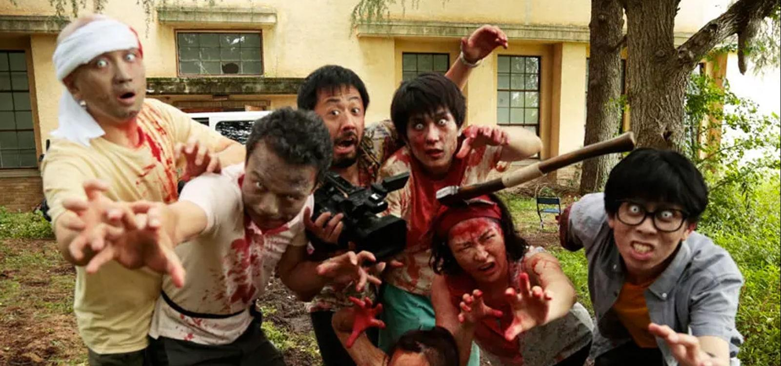 Director Higurashi (Takayuki Hamatsu), center, surrounded by the zombified cast of One Cut of the Dead.