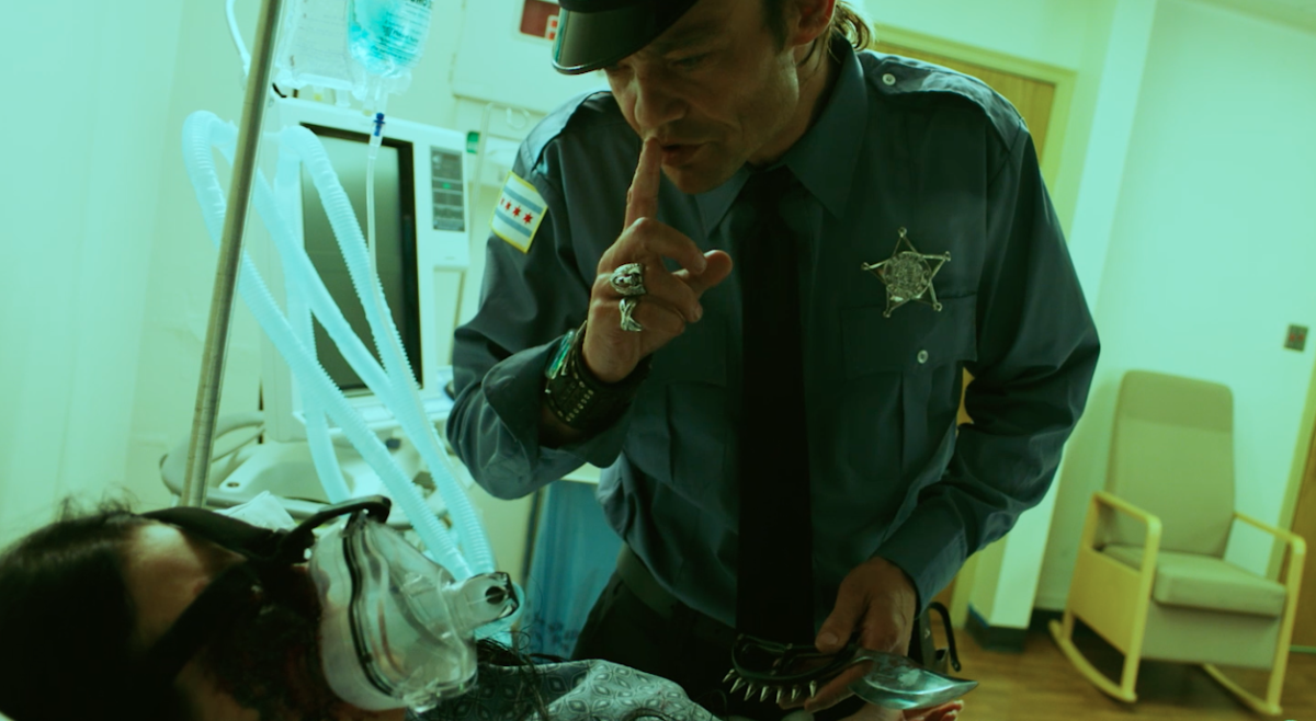 'Mollywood' Clip: A Serial Killer Impersonates a Police Officer [Exclusive]